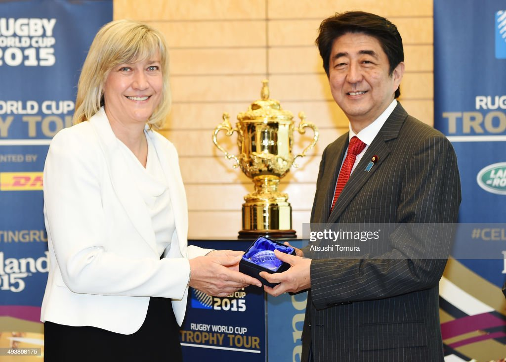England Rugby 2015 Chief Executive Debbie Jevans and Japanese Prime Minister Shinzo Abe pose with The Webb Ellis Cup during the Rugby World Cup...
