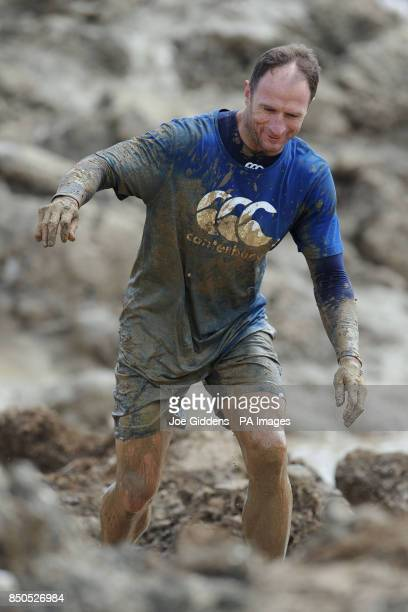 England rugby attack coach Mike Catt takes part in Tough Mudder 2013 at Boughton House Kettering