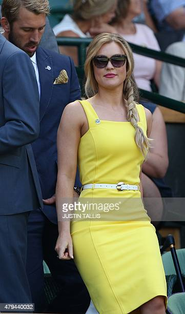 England rugby captain Chris Robshaw and partner Camilla Kerslake take their seats in the royal box on centre court before the start of the men's...
