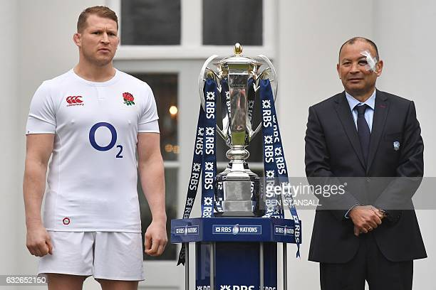 England rugby captain Dylan Hartley and England's Australian coach Eddie Jones pose with the trophy at the official launch of the 2017 Six Nations...