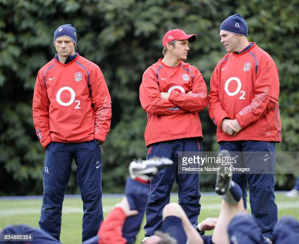 Calvin Morriss Brian Smith and John Wells watch during a training session at PennyHill Park Bagshot Surrey
