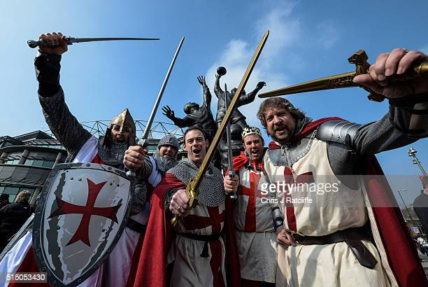 England rugby fans Alan Rosten Simon Smith Colin Clark Will Littleboy and Neil Carter arrive at Twickenham stadium dressed as English Knights under...