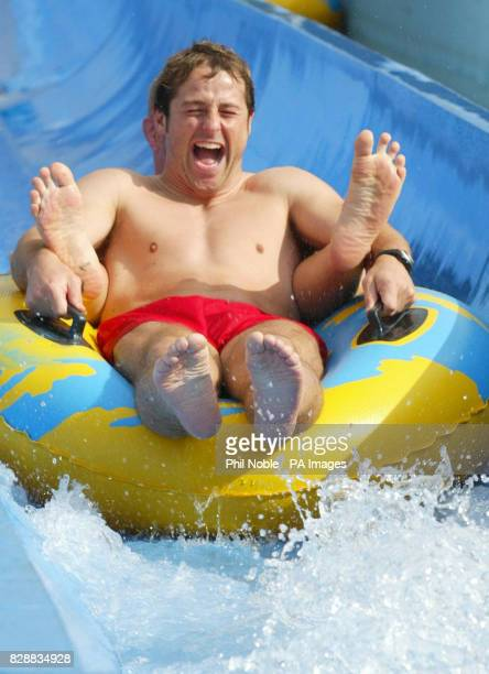 England rugby player Andy Gomarsall slides down a water chute during a team trip to the 'Wet and Wild' water park near Brisbane's Gold Coast England...