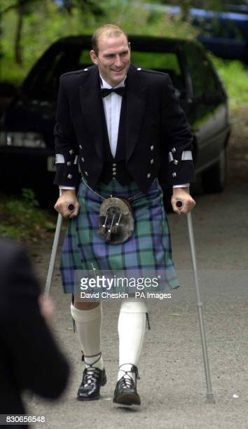 England rugby player Lawrence Dallaglio arrives on crutches at the wedding of rugby player Kenny Logan and TV presenter Gabby Yorath at Logie Kirk in...