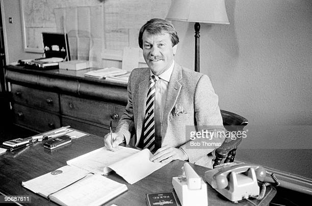 England Rugby Union coach Dick Greenwood behind his desk at Stoneyhurst College near Clitheroe Lancashire where he is employed as assistant bursar on...