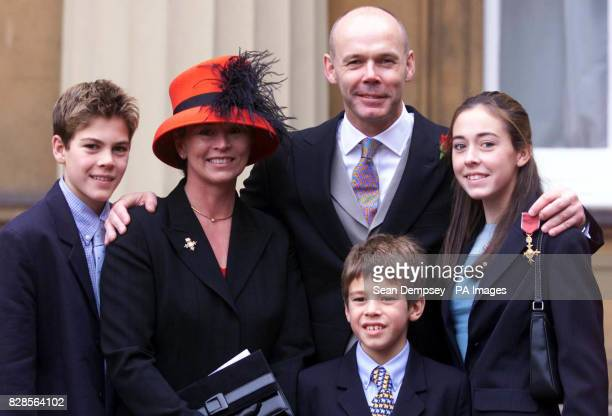 England Rugby Union manager Clive Woodward with his family after receiving his OBE from the Queen outside Buckingham Palace * They are Joe wife Jayne...