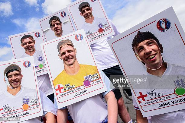 England S dressed as collectible football trading cards pose for a photograph in central Lens on June 16 before the Euro 2016 football match England...