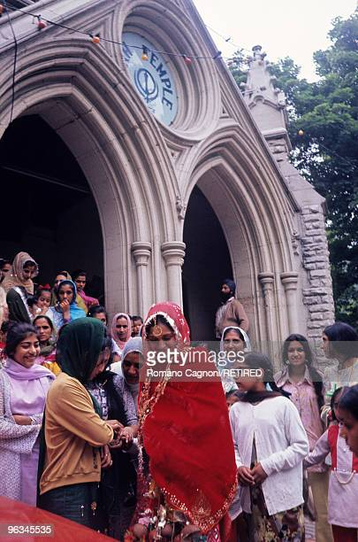 England Sikh Temple in Chapeltown Road Leeds a converted Christian church Female worshippers come out after an arranged wedding has been celebrated