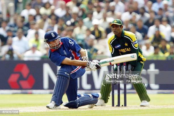 England skipper Michael Vaughan sweeps a delivery from Pakistan's Mohammad Hafeez during his innings in the NatWest Challenge match at Old Trafford...