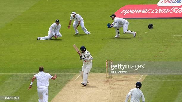 England slip fielder Graeme Swann catches India batsman Sachin Tendulkar during day three of the 1st npower test match between England and India at...