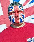England soccer fan with face painted as Union flag, close-up, portrait