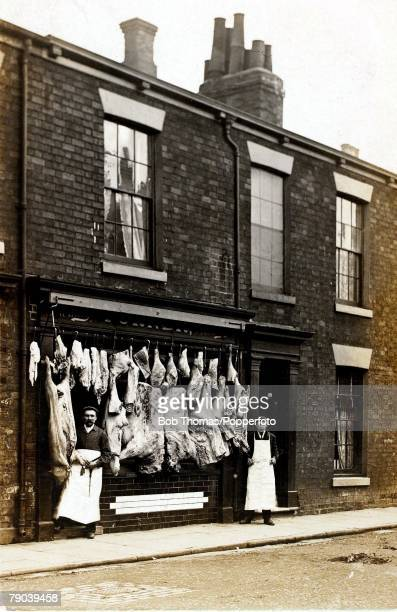England Social History A butchers shop with display of meat in a terraced row of houses circa 1910