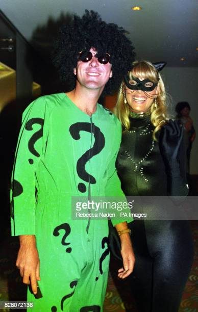 England spin bowler Phil Tufnell wears the costume of the costume of the Riddler and his wife Lisa wears the costume of Catwoman before the start of...