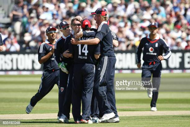 England spinner Graeme Swann celebrates with team mates after bowling Chris Gayle during the Second One Day International at The County Ground Bristol