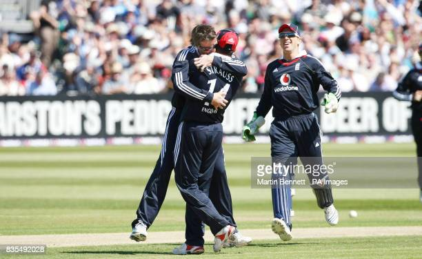 England spinner Graeme Swann hugs captain Andrew Strauss after bowling Chris Gayle during the Second One Day International at The County Ground...
