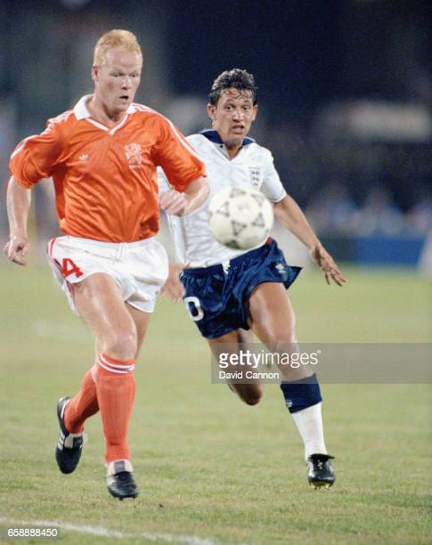 England striker Gary Lineker chases down Ronald Koeman of the Netherlands during the 1990 FIFA World Cup match at Cagliari on June 16 1990 in...
