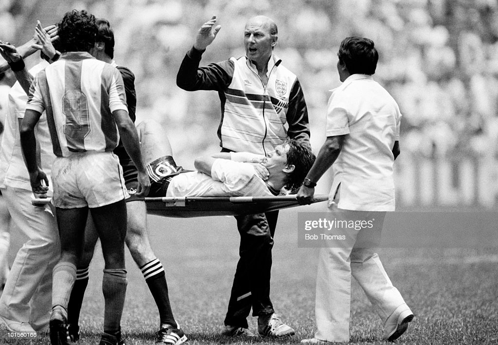 England striker Gary Lineker is stretchered off, supervised by physiotherapist Fred Street, following an injury during the World Cup Finals Round of 16 match against Paraguay held at the Azteca Stadium in Mexico City on 18th June 1986. England beat Paraguay 3-0. (Bob Thomas/Getty Images).