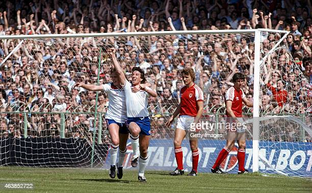 England striker Paul Mariner and Peter Barnes celebrate after Mariner had opened the scoring in the 1980 Home International match between Wales and...