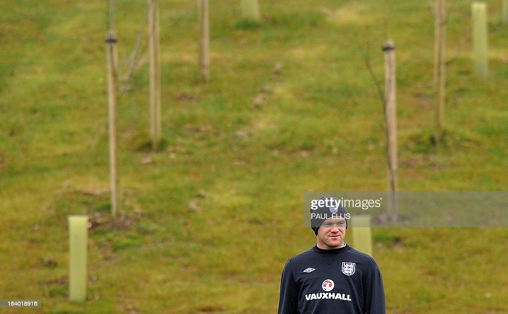 England striker Wayne Rooney takes part in a training session at the St George's Park training complex, near Burton-upon-Trent, central England on March 19, 2013 ahead of their 2014 World Cup qualifier football match against San Marino on March 22. AFP PHOTO / PAUL ELLIS NOT FOR MARKETING OR ADVERTISING USE / RESTRICTED TO EDITORIAL USE