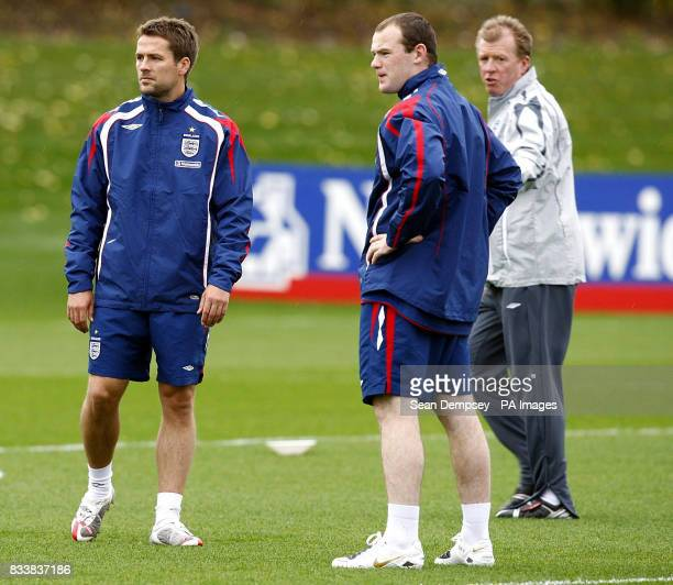 England strikers Michael Owen and Wayne Rooney with manager Steve McClaren during a training session at London Colney Hertfordshire
