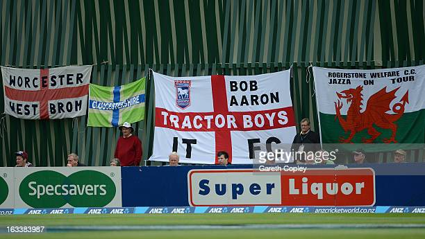 England supporters display flags of support during day four of the First Test match between New Zealand and England at University Oval on March 9...