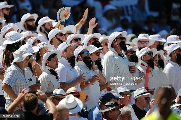 England supporters from the Barmy Army sing an hymn wearing a mock beard which look like the one of South Africa Captain Hashim Amla during day two...