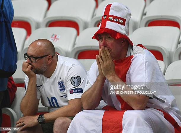 England supporters react after the Euro 2016 round of 16 football match between England and Iceland at the Allianz Riviera stadium in Nice on June 27...