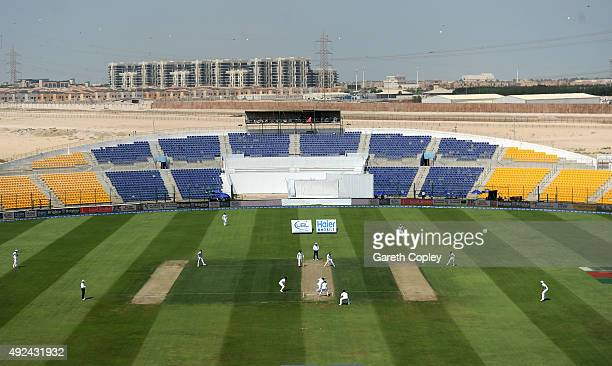 England take to field after lunch during the 1st Test between Pakistan and England at Zayed Cricket Stadium on October 13 2015 in Abu Dhabi United...