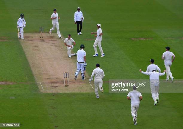 England team mates rush tocongratulate Jimmy Anderson of England after a return catch to dismiss Chris Morris of South Africa lbw during Day Two of...