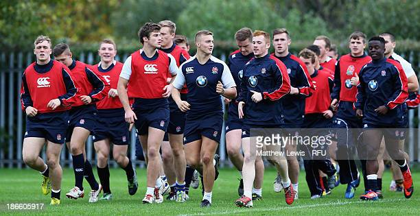 England U18's warm up during a training session at Loughborough University on November 1 2013 in Loughborough England