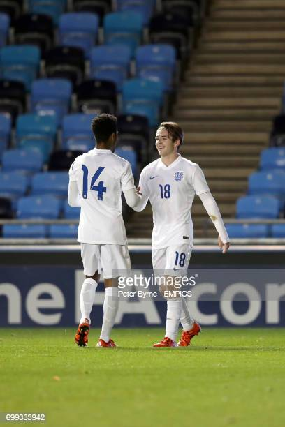 England U19's Rico Henry and Dan Rowley celebrate Rowleys goal his side's fifth of the game