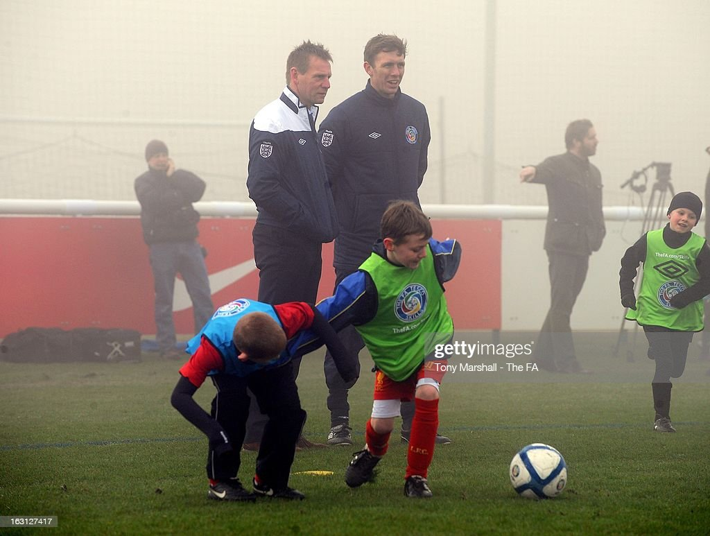 England U21 manager <a gi-track='captionPersonalityLinkClicked' href=/galleries/search?phrase=Stuart+Pearce+-+Soccer+Coach&family=editorial&specificpeople=213348 ng-click='$event.stopPropagation()'>Stuart Pearce</a> (L) attends the Tesco Skills Extra Launch at St Georges Park on March 5, 2013 in Burton-upon-Trent, England.