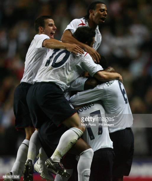 England U21's Anton Ferdinand and Steven Taylor celebrate after Leighton Baines scored during the UEFA Under 21 Championship playoff against Germany...