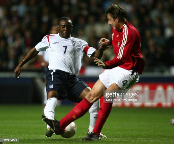 England U21's captain Nigel ReoCoker tussles with Germany U21's Markus Brzenska during the UEFA Under 21 Championship playoff at the Ricoh Arena...