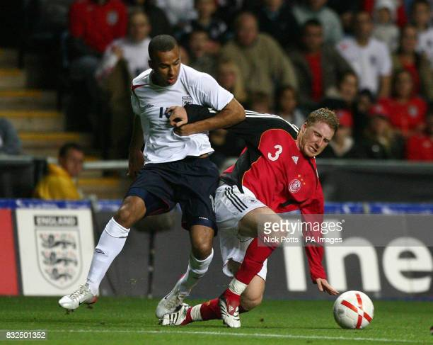 England U21's Gabriel Agbonlahor tussles for the ball with Germany U21's Patrick Ochs during the UEFA Under 21 Championship playoff at the Ricoh...
