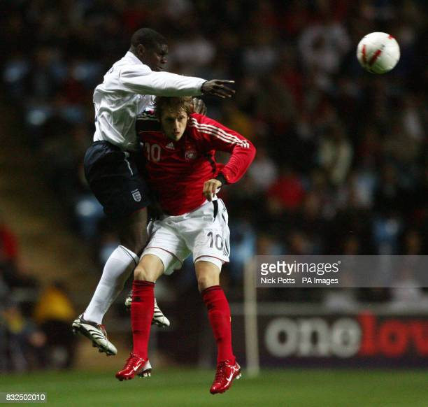 England U21's Micah Richards wins a header over Germany U21's Aaron Hunt during the UEFA Under 21 Championship playoff at the Ricoh Arena Coventry