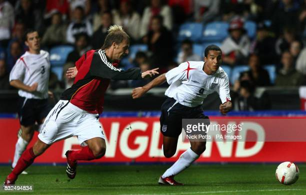 England U21's Theo Walcott runs past Germany U21's Dominik Reinhardt during the UEFA Under 21 Championship playoff at the Ricoh Arena Coventry
