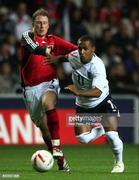 England U21's Wayne Routledge tussles with Germany U21's Patrick Ochs during the UEFA Under 21 Championship playoff at the Ricoh Arena Coventry