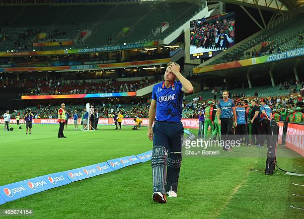 England vice captain Jos Buttler looks dejected as he leaves the field after the 2015 ICC Cricket World Cup match between England and Bangladesh at...