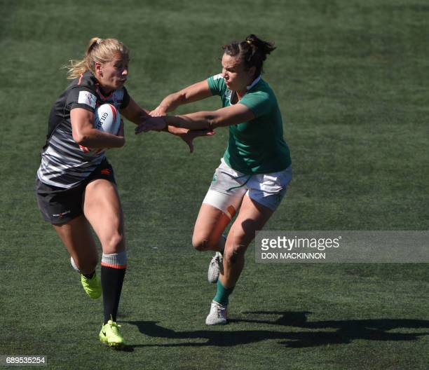 England vies with Ireland in the HSBC Canada Women's Sevens Rugby tournament at Westhills Stadium in Langford BC Canada May 28 2017 / AFP PHOTO / Don...