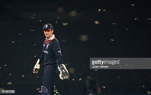 England wicket keeper Steve Davies leaves the field before Australias innings when a swarm of flying ants arrived during The 1st ICC Champions Trophy...
