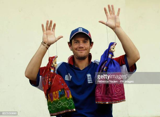 England wicketkeeper Chris Read tries to move the strings of some traditional Indian puppets at the team hotel Ahmedabad India