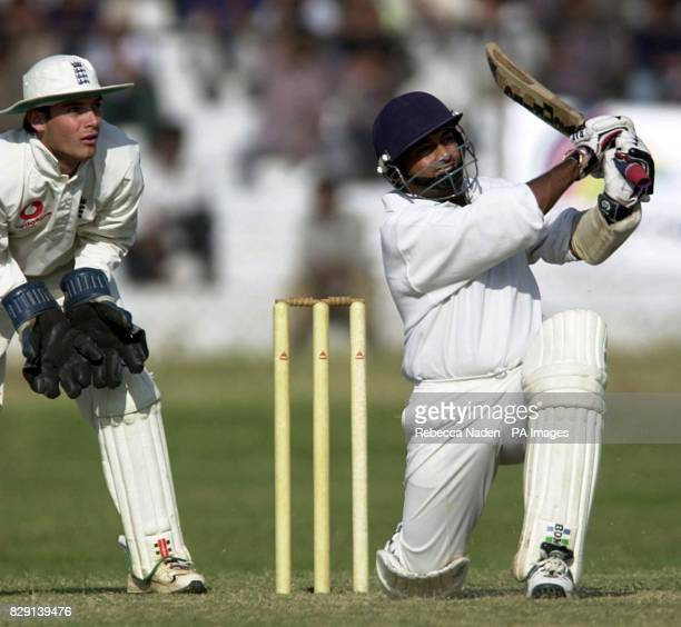 England wicketkeeper James Foster watches as India 'A' batsman Abhijit Kale hits the ball to score his century during the first day of the three day...