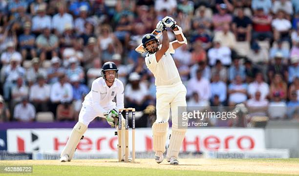 England wicketkeeper Jos Buttler looks on as India batsman Rohit Sharma hits out during day three of the 3rd Investec Test between England and India...