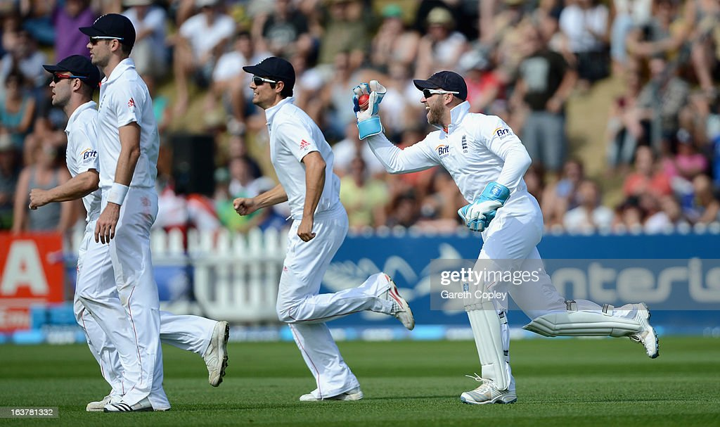England wicketkeeper <a gi-track='captionPersonalityLinkClicked' href=/galleries/search?phrase=Matt+Prior+-+Cricket+Player&family=editorial&specificpeople=13652111 ng-click='$event.stopPropagation()'>Matt Prior</a> celebrates alongside James Anderson, <a gi-track='captionPersonalityLinkClicked' href=/galleries/search?phrase=Jonathan+Trott&family=editorial&specificpeople=654505 ng-click='$event.stopPropagation()'>Jonathan Trott</a> and <a gi-track='captionPersonalityLinkClicked' href=/galleries/search?phrase=Alastair+Cook+-+Cricket+Player&family=editorial&specificpeople=571475 ng-click='$event.stopPropagation()'>Alastair Cook</a> after catching out Neil Wagner of New Zealand during day three of the second Test match between New Zealand and England at Basin Reserve on March 16, 2013 in Wellington, New Zealand.