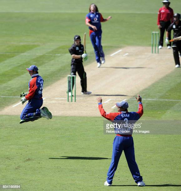 England wicketkeeper Phil Mustard leaps during the Fourth One Day International match at McLean Park Napier New Zealand