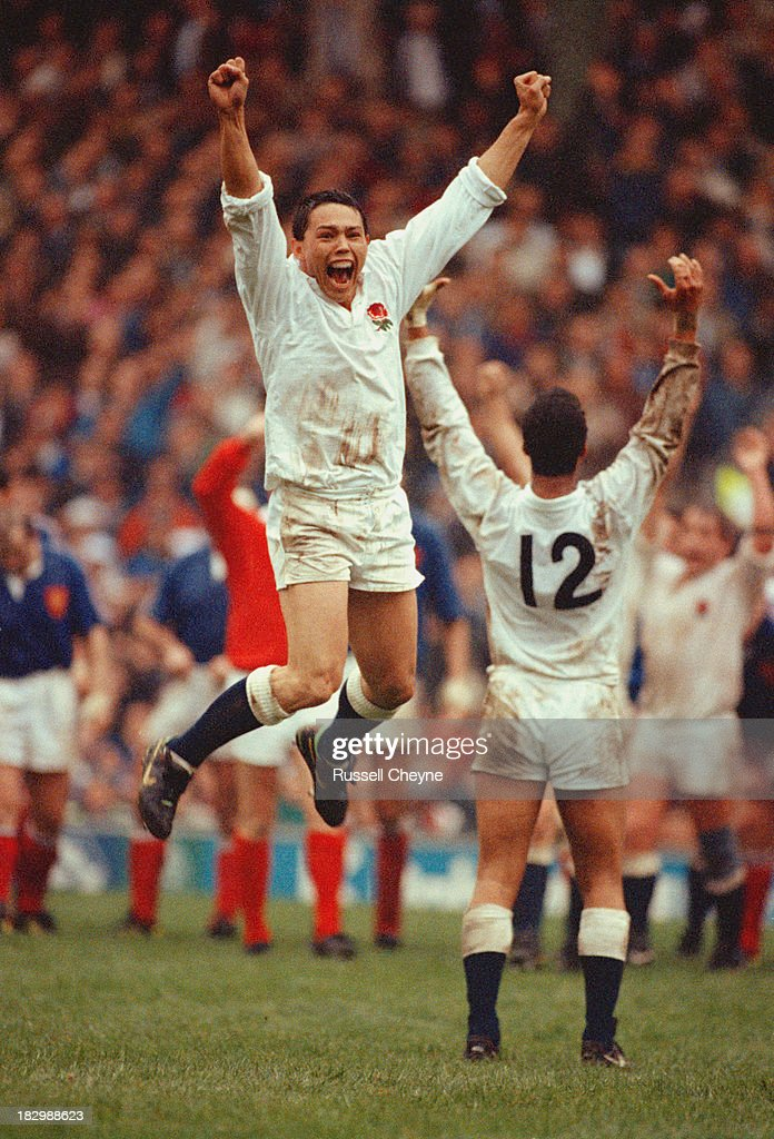 England winger <a gi-track='captionPersonalityLinkClicked' href=/galleries/search?phrase=Rory+Underwood&family=editorial&specificpeople=2219929 ng-click='$event.stopPropagation()'>Rory Underwood</a> jumps in celebration as England defeat France 21-19 to win the Grand Slam at the Five Nations Championship on 16th March 1991 at the Twickenham Stadium, London, United Kingdom.