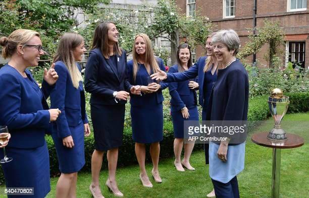 England women's cricket team captain Heather Knight introduces Britain's Prime Minister Theresa May to her teammates as they stand by the ICC Women's...