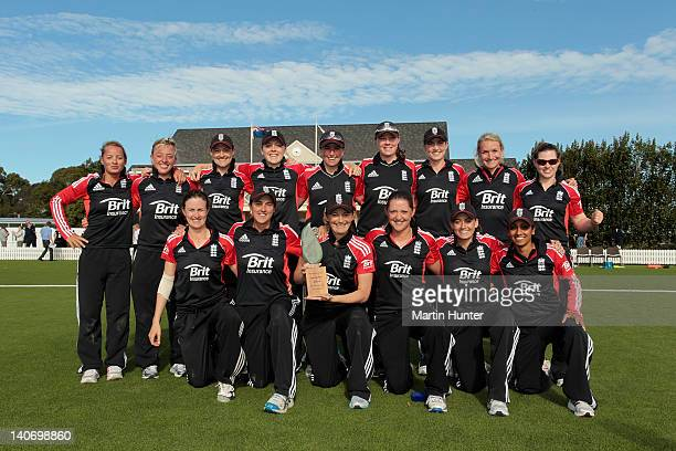England Women's cricket team celebrate with the Hockley Trophy after winning the women's 3rd One Day International match between New Zealand and...