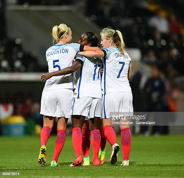 England women's Danielle Carter centre celebrates completing her hattrick after scoring his sides fourth goal with teammates Steph Houghton left and...
